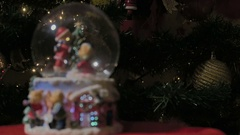 Christmas snow globe ball before blurred background with space for text. Stock Footage