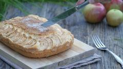 Woman cut apple pie. Slicing homemade apple pie outdoors Stock Footage