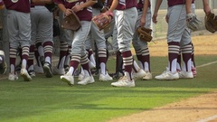A baseball team huddles before a game, slow motion. Stock Footage