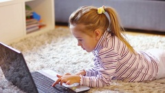 Little girl with laptop at home. Smart preschool child using computer Stock Footage