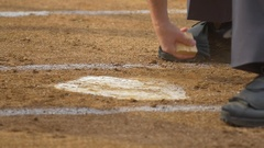 The umpire at a baseball game brushes off home plate. Stock Footage