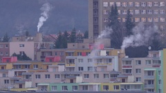 Morning smoke rising from chimneys in the city Stock Footage