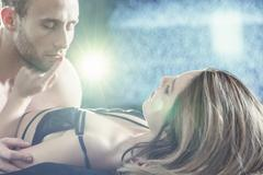 Attractive couple during foreplay Stock Photos