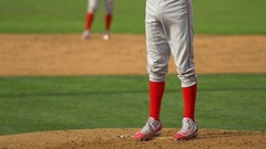 A pitcher makes a play at a baseball game, slow motion. Stock Footage
