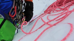 A man goes ice climbing on a mountain in the winter. Stock Footage