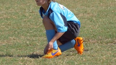 Details of a boy tying his soccer football shoes. Stock Footage