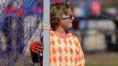 A goalie playing youth soccer football on a grass field. Stock Footage