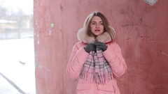 Girl straightens her scarf and gloves Stock Footage