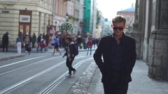 Young handsome guy walking in the city center Stock Footage