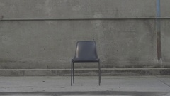 A char sits empty in a lonely stark place, super slow motion. Stock Footage