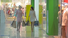 Beauty friends shopping in trade center Stock Footage