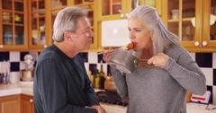Charming senior white couple tasting cooking sauce Stock Footage