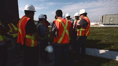Engineers and Construction Workers Working on Green Environmental Roof Stock Footage