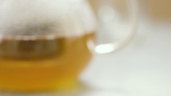 Hot tea in glass teapot. Film clip with sliding motion. Stock Footage