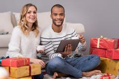 Positive good looking man holding a tablet Stock Photos