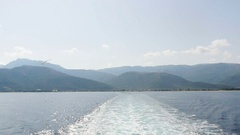 Cinematic boat leaving island Stock Footage
