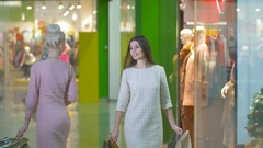 Beauty girls, friends shopping in trade center Stock Footage