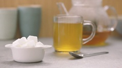 Putting sugar cubes in hot tea. Adding sweetener to teacup. Stock Footage