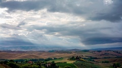 Cloudy sunrise in San Quirico d'Orcia in Italy Stock Footage