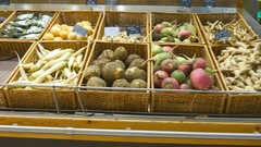 Moving past fresh vegetables in a supermarket. Grocery aisles in the store Stock Footage