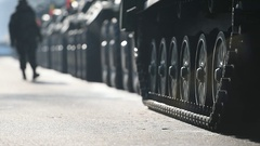 Detail shot with green tank tracks and wheels during military parade Stock Footage