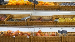 Moving past fresh fruits in a supermarket grocery. Shelves at the shop. Close up Stock Footage