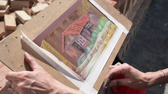 The girl draws with pastel crayon. Drawing on the board Stock Footage