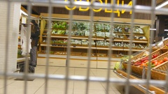 Supermarket cart riding. Camera inside trolley going through grocery store. Arkistovideo