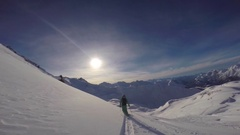 POV of a man skiing in the mountains in fresh powder snow, slow motion. Stock Footage