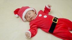 Cute little baby boy lie wearing Santa Claus hat. Stock Footage