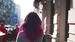 Fashionable girl listening to music outdoors Stock Footage