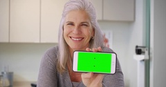 Good looking Caucasian woman in medical clinic holding smartphone Stock Footage
