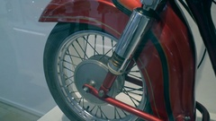 Old vintage red motorbike wheel shock absorber demonstration Stock Footage