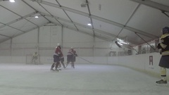 Men playing ice hockey in a skating rink. Stock Footage