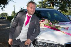 The groom in front of white luxury car in wedding Kuvituskuvat
