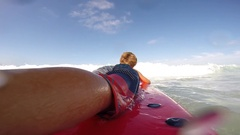 POV of a boy learning to surf at the beach, slow motion. Stock Footage
