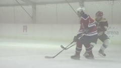 An ice hockey player takes a shot with the puck at the goal. Stock Footage