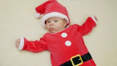 Cute little baby boy lie wearing Santa Claus hat. Stock Footage