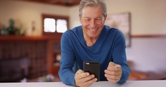 Handsome mid aged man making phone call with cellphone Stock Footage