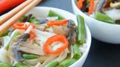 Gluten free roasted teriyaki mushrooms and asparagus rice noodles Stock Footage