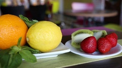 Fresh fruit plate on the table Stock Footage