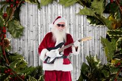Santa claus playing guitar against digitally generated background Stock Photos