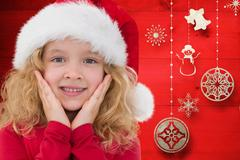 Surprised girl in santa hat against digitally generated background Stock Photos