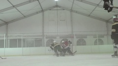 Men playing ice hockey in a skating rink, slow motion. Stock Footage