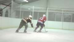 An ice hockey player takes a shot with the puck at the goal, super slow motion. Stock Footage