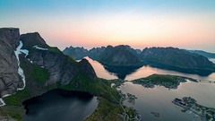 Midnight sun over Reine, Lofoten, Norway Stock Footage