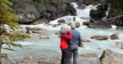 Caucasian couple enjoying waterfall, Lake Louise, Alberta, Canada Stock Footage