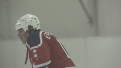 Men playing ice hockey in a skating rink, super slow motion. Stock Footage