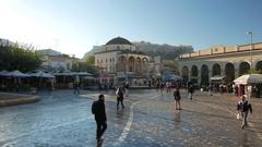 4K TL Greece Athens Commuters Monastiraki square Tsisdarakis Mosque Acropolis Stock Footage