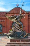Sculpture of Archangel Michael, striking winged serpent, Minsk, Belarus Stock Photos